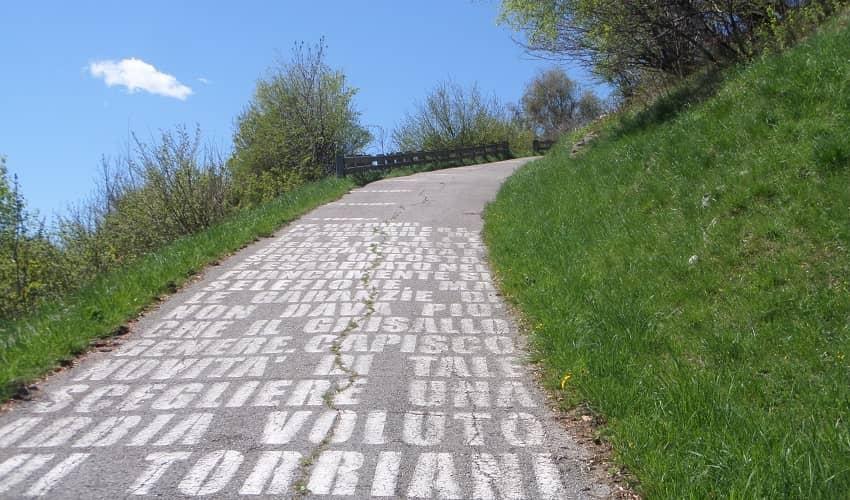 Writing on the Muro di Sormano Climb